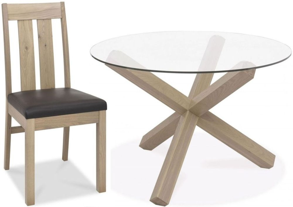 https://www.firstfurniture.co.uk/pub/media/catalog/product/3/-/3-bentley-designs-turin-aged-oak-dining-set-round-glass-top-dining-table-with-slatted-chairs_1.jpg