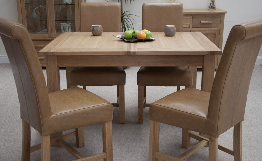 https://www.firstfurniture.co.uk/pub/media/catalog/product/3/-/3-homestyle-gb-opus-oak-dining-set-extending-with-4-louisa-tan-dining-chairs.jpg