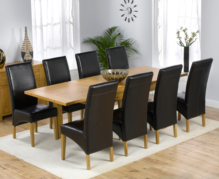 https://www.firstfurniture.co.uk/pub/media/catalog/product/r/u/rustique_extending_150cm_dt_with_8_roma_chairs.jpg